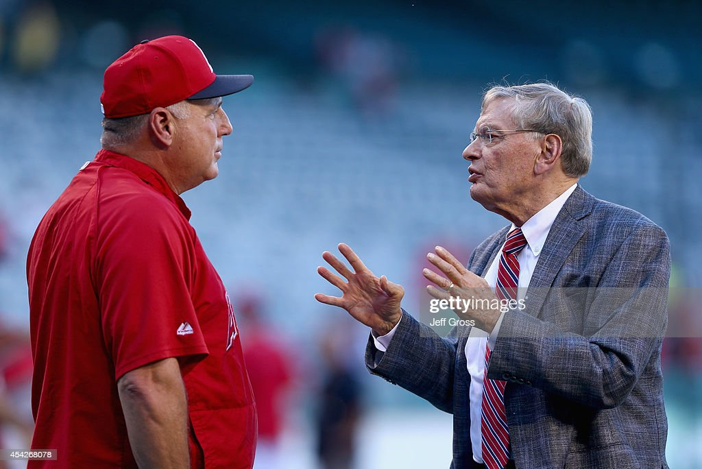 Los Angeles Angels of Anaheim manager, Mike Scioscia, (L) and Commissioner of Major League Baseball, Bud Selig, talk prior to the start of the game against the Miami Marlins at Angel Stadium of Anaheim on August 27, 2014 in Anaheim, California.
