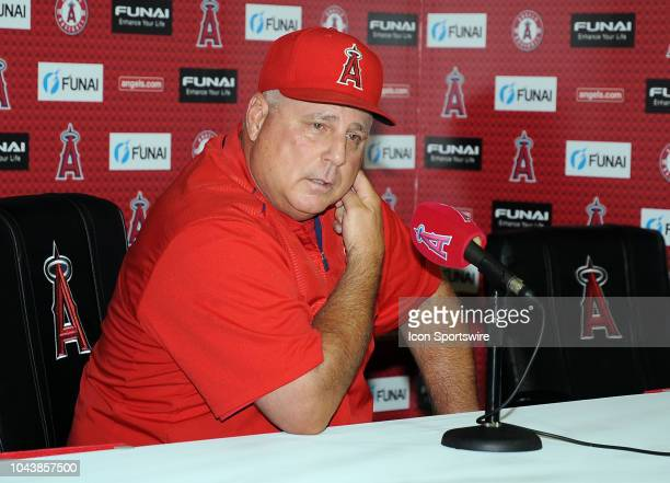 Los Angeles Angels of Anaheim manager Mike Scioscia gets emotional while he announces his retirement at a postgame press conference after the Angels...