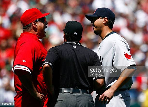 Los Angeles Angels of Anaheim manager Mike Scioscia is seperated by umpire Ed Rapuano while arguing with pitcher Josh Beckett of the Boston Red Sox...