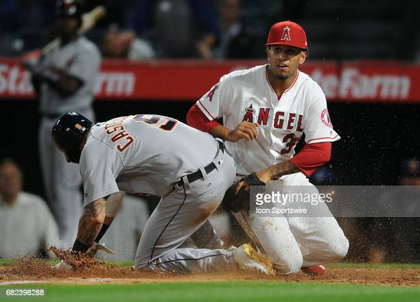 Los Angeles Angels of Anaheim pitcher Keynan Middleton tags Detroit Tigers runner Nicholas Castellanos out at the plate during the ninth inning of a...