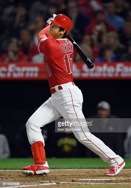 Los Angeles Angels of Anaheim pitcher Shohei Ohtani hits a three run home run in the first inning of a game against the Cleveland Indians played on...