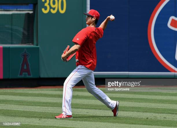 Los Angeles Angels of Anaheim pitcher Shohei Ohtani warms up in the outfield during batting practice before a game against the Houston Astros played...