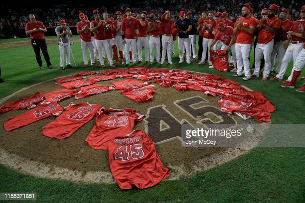 Los Angeles Angels of Anaheim players lay their jerseys on the pitchers mound after they won a combined nohitter against the Seattle Mariners at...