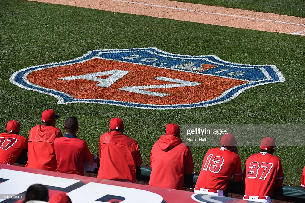 Los Angeles Angels of Anaheim players watch play from the top step of the dugout during a game against the San Francisco Giants at Tempe Diablo Stadium on March 12, 2016 in Tempe, Arizona.
