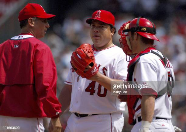 Los Angeles Angels of Anaheim reliever Bartolo Colon talks with pitching coach Bud Black and catcher Jeff Mathis during 101 loss to the New York...