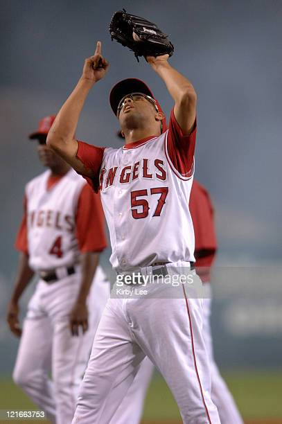 Los Angeles Angels of Anaheim reliever Francisco Rodriguez points skyward in celebration after the final out of 97 victory over the Seattle Mariners...
