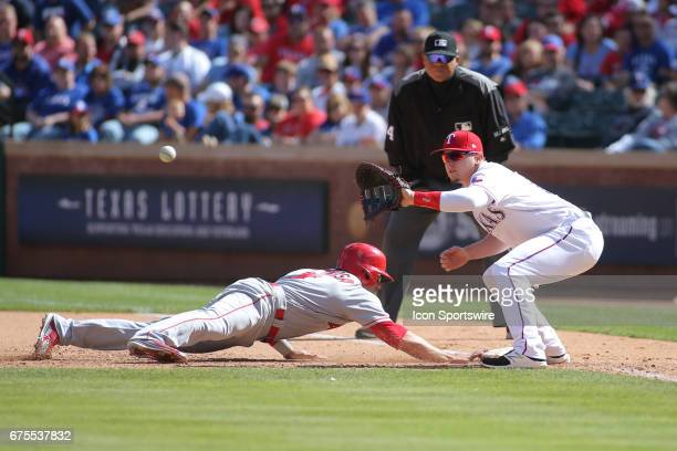 Los Angeles Angels of Anaheim Second base Danny Espinosa dives back to first base to avoid a tag by Texas Rangers First base Ryan Rua during the game...
