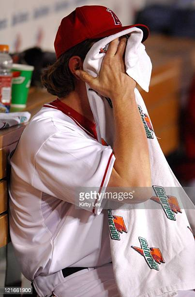 Los Angeles Angels of Anaheim starter Jered Weaver wipres his face with a Gatorade towel in frustration after being removed in the second inning of...