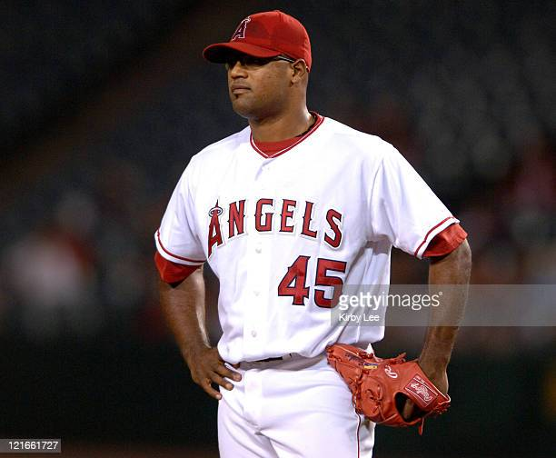 Los Angeles Angels of Anaheim starting pticher Kelvim Escobar stands on the mound dejectedly during 5-2 loss to the Texas Rangers at Angel Stadium in...