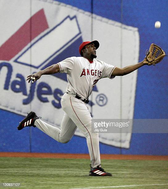 Los Angeles Angels of Anaheim's Vladimir Guerrero makes an attempt to catch up to this wellhit fly ball versus the Toronto Blue Jays at Rogers Centre...