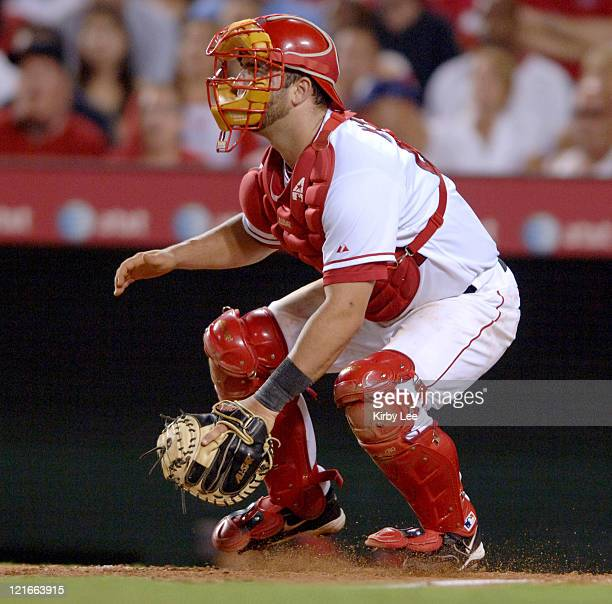 Los Angeles Angels of Anahiem catcher Mike Napoli awaits a throw to home plate during 105 victory over the Cleveland Indians at Angel Stadium in...