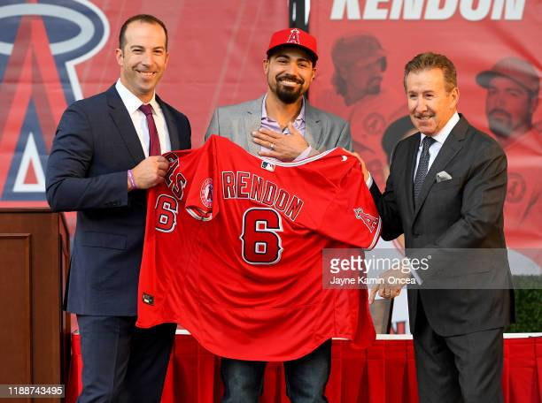 Los Angeles Angels owner Arte Moreno and general manager Billy Eppler look on as All-Star infielder Anthony Rendon is presented his jersey during a...