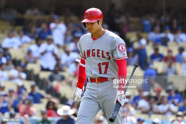 Los Angeles Angels pinch hitter Shohei Ohtani walks back to the dugout after striking out in the 9th inning during a MLB game between the Los Angeles...