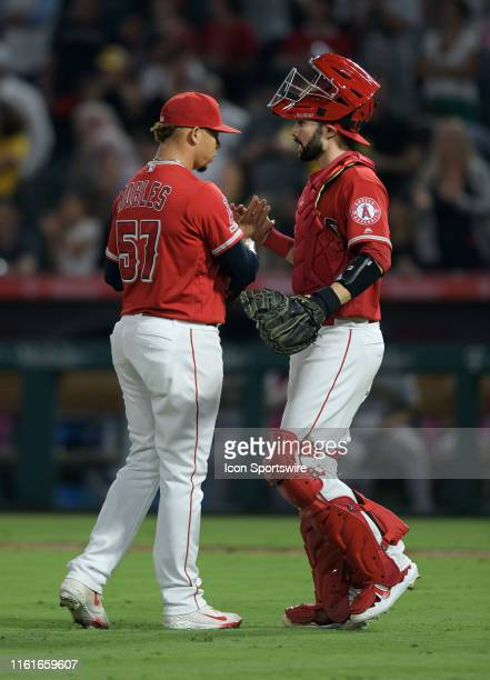 Los Angeles Angels pitcher Hansel Robles and Los Angeles Angels catcher Anthony Bemboom on the field after the Angels defeated the Pittsburgh Pirates...