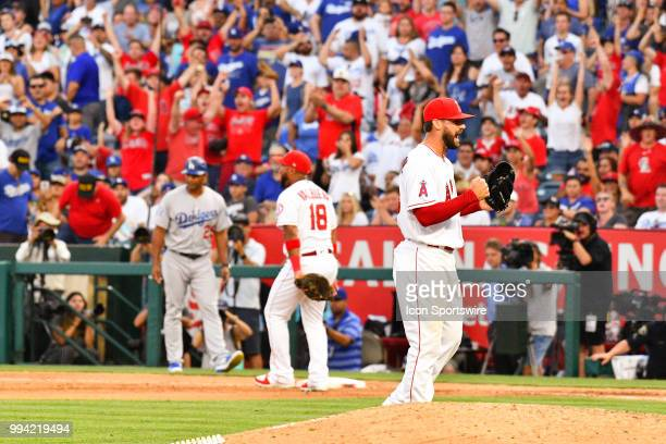 Los Angeles Angels pitcher Justin Anderson celebrates Los Angeles Dodgers first baseman Cody Bellinger hitting into a game ending double play during...