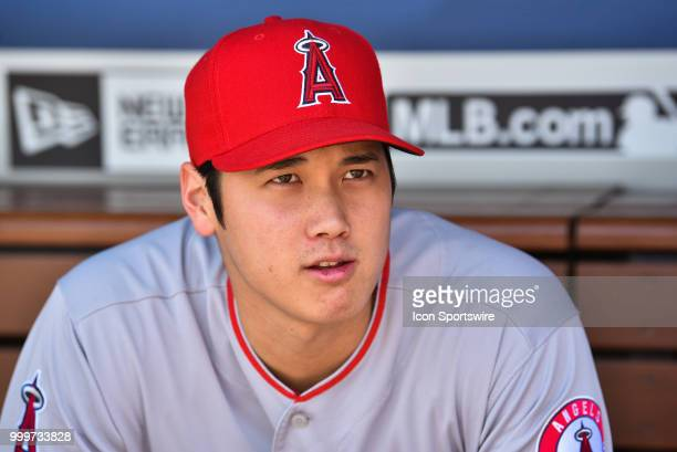 Los Angeles Angels pitcher Shohei Ohtani looks on from the dugout during a MLB game between the Los Angeles Angels of Anaheim and the Los Angeles...
