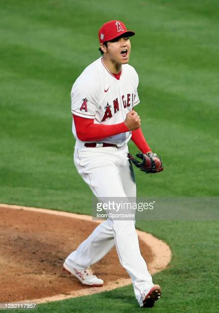 Los Angeles Angels pitcher Shohei Ohtani reacts after getting a strike out for the final out of the fourth inning of a game against the Chicago White...