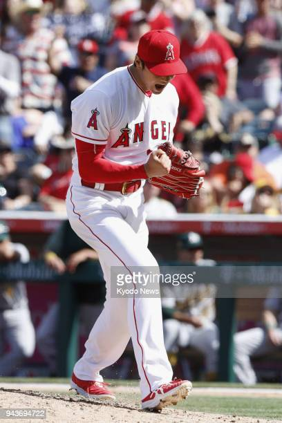 Los Angeles Angels pitcher Shohei Ohtani reacts after striking out Matt Olson of the Oakland Athletics in the seventh inning at Angel Stadium in...