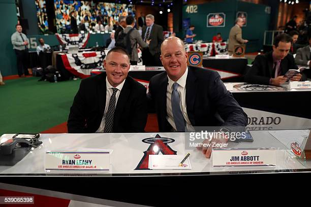 Los Angeles Angels representatives Ryan Leahy and Jim Abbott pose for a photo prior to the 2016 Major League Baseball FirstYear Player Draft at the...