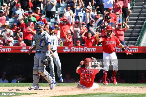 Los Angeles Angels right fielder Kole Calhoun scores the tying run with Los Angeles Angels designated hitter Albert Pujols during a MLB game between...