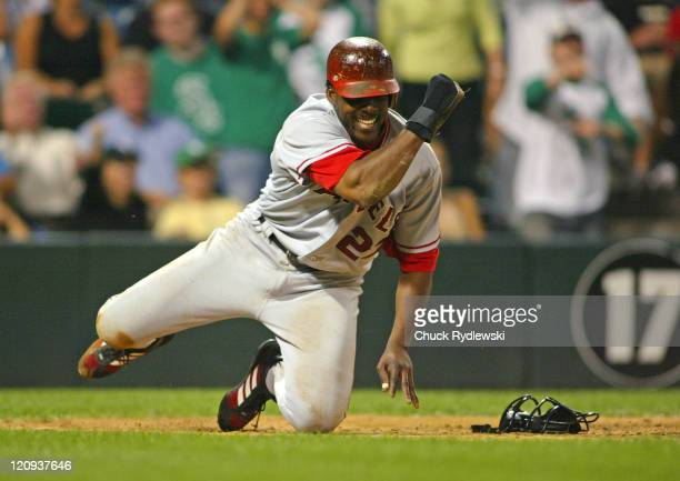 Los Angeles Angels' Right Fielder Vladimir Guerrero reacts to scoring from 2nd base on a sacrifice bunt in the 13th inning against the Chicago White...