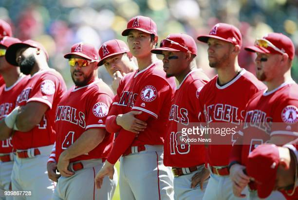 Los Angeles Angels rookie Shohei Ohtani and teammates line up during an Opening Day ceremony before a game against the Oakland Athletics on March 29...