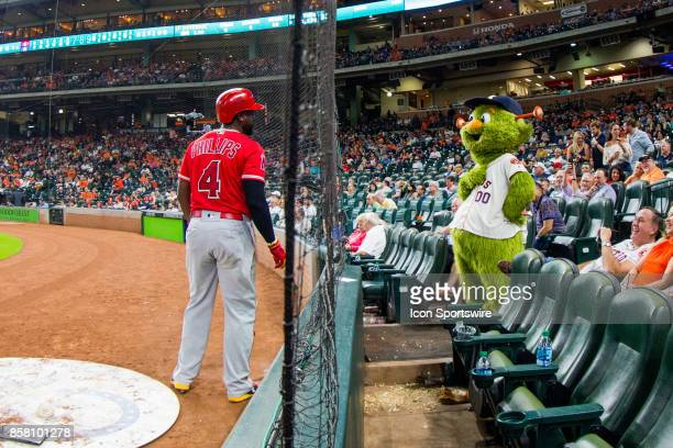 Los Angeles Angels second baseman Brandon Phillips jokes with Houston Astros mascot Orbit in the seventh inning during an MLB game between the...