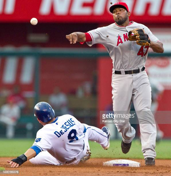 Los Angeles Angels second baseman Howard Kendrick forces out Kansas City Royals' David DeJesus and completes the double play on Billy Butler to end...