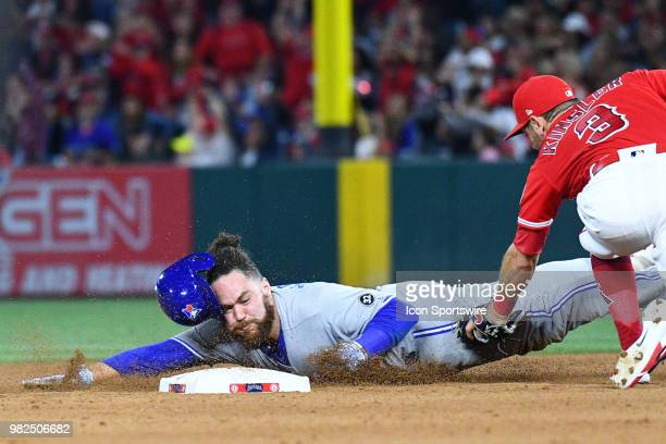 Los Angeles Angels second baseman Ian Kinsler tags out Toronto Blue Jays catcher Russell Martin trying to steal during a MLB game between the Toronto...