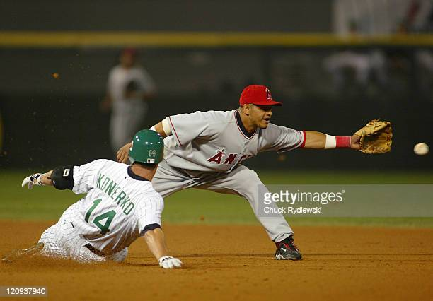 Los Angeles Angels' Shortstop Orlando Cabrera stretches for a throw as Paul Konerko slides safely into 2nd base with a double during the game against...