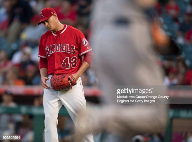 Los Angeles Angels starting pitcher Garrett Richards reacts as Josh Reddick rounds the bases after the Houston Astros' Evan Gattis hit a tworun home...