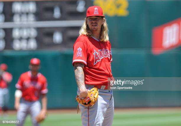 Los Angeles Angels starting pitcher John Lamb looks in for the sign during the regular season game between the Oakland Athletics and the Los Angeles...