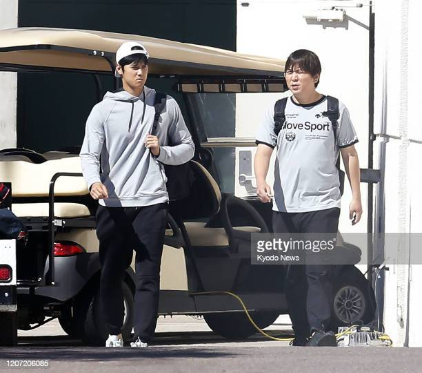 Los Angeles Angels twoway player Shohei Ohtani and his interpreter Ippei Mizuhara leave after a brief stay at the team's spring training site in...