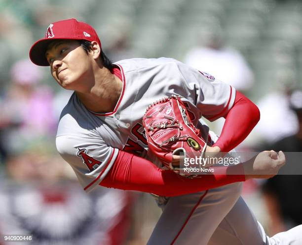 Los Angeles Angels two-way player Shohei Ohtani pitches against the Oakland Athletics on April 1 in Oakland, California. Ohtani won on his major...