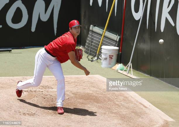 Los Angeles Angels two-way player Shohei Ohtani throws a bullpen session at Angel Stadium in Anaheim, California, on June 26 his first since...
