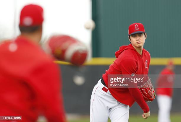 Los Angeles Angels' two-way player Shohei Ohtani throws during the team's spring training in Tempe, Arizona, on March 8, 2019. He threw for the first...