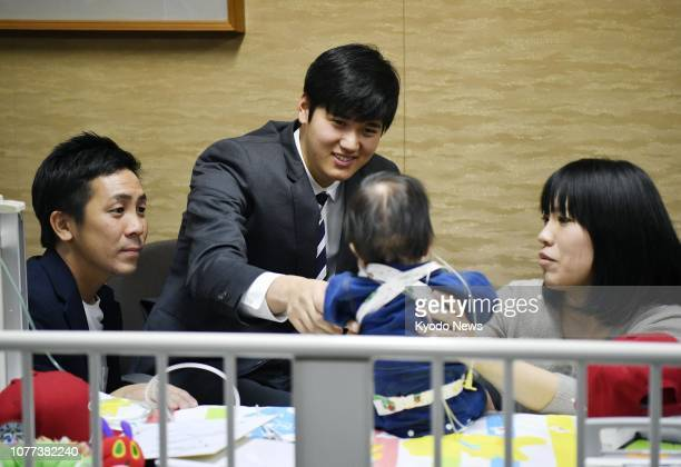 Los Angeles Angles star Shohei Ohtani is seen on Jan 5 cheering up 1yearold Shohei Kawasaki who is being treated at a hospital in Suita Osaka...