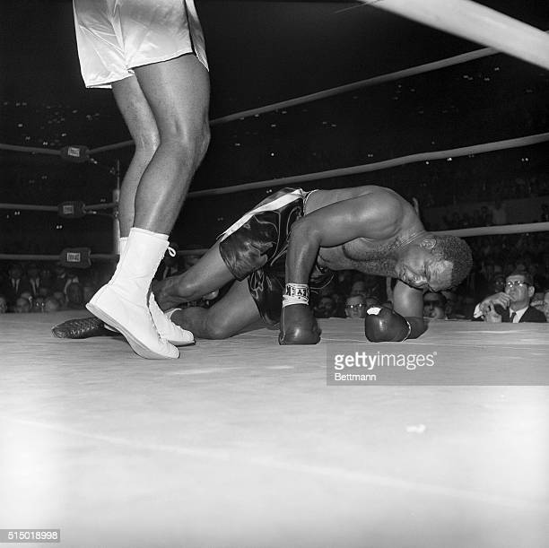 Los Angeles Archie Moore hits the canvas in the fourth round here in one of three knockdowns that spelled his defeat by Cassius Clay The 20yearold...