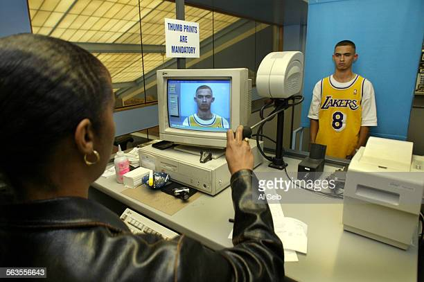 Los Angeles At the State of California Department of Motor Vehicles Office on South Hope Street in LA Marlon Aguilar is having his photo taken before...