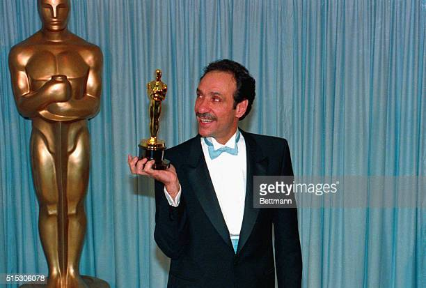 Best actor F Murray Abraham receives Oscar from Shirley MacLaine at the Academy Awards in Los Angeles