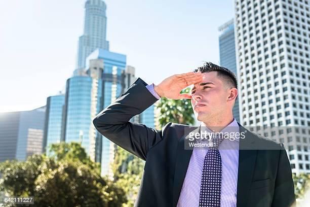 USA, Los Angeles, businessman looking around