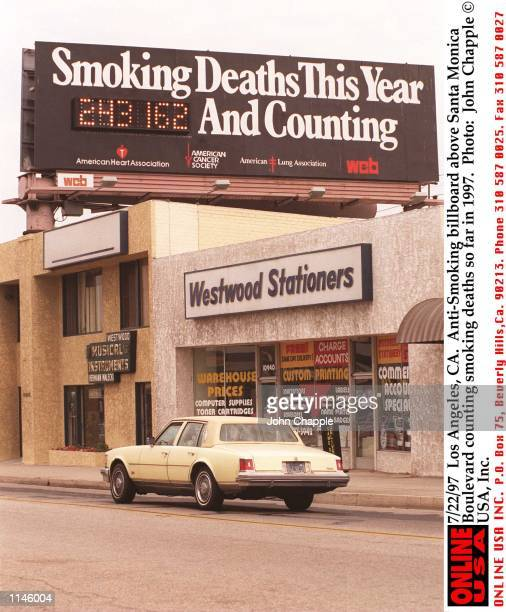 Los Angeles CA AntiSmoking billboard above Santa Monica Boulevard counting smoking deaths so far in 1997
