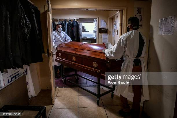 Los Angeles, CA, August 5, 2020 - Continental Funeral Home attendants move the casket containing the body of Rafael Martinez moments after Iris...