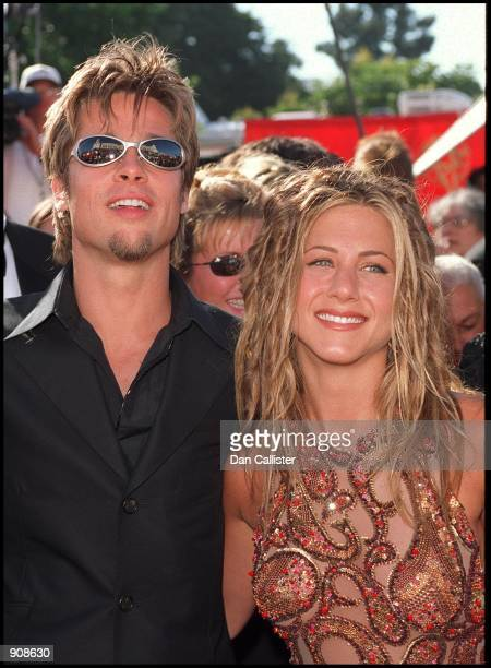 09/12/99 Los Angeles CA Brad Pitt and Jennifer Aniston arrive at the 51st Annual primetime EMMY Awards The awards were held at the Shrine Auditorium...