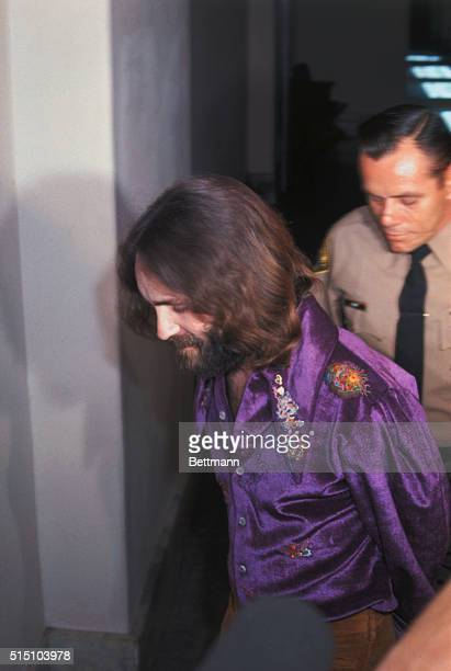 Charles Manson leader of a hippie cult whose members are accused of the murder of actress Sharon Tate and several other persons last year wears a...