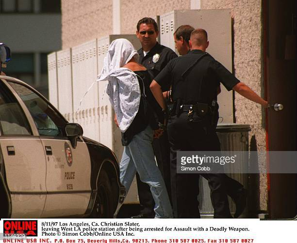Los Angeles Ca Christian Slater leaving West LA police station after being charged with Assault with a Deadly Weapon