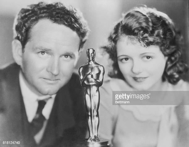 Closeup of Janet Gaynor and Frank Borzage with an Academy Award in the foreground center Janet Gaynor won the first Oscar for Best Actress for her...