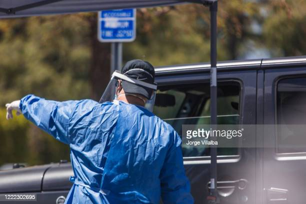 los angeles ca covid-19 testing site for all citizens - drive through stock pictures, royalty-free photos & images
