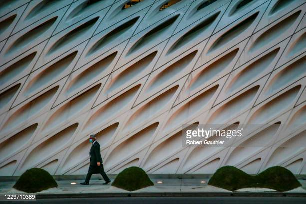 Los Angeles, CA, Friday, November 20, 2020 - A lone pedestrian walks past the closed Broad Museum as Covid-19 cases surge and restrictions are...