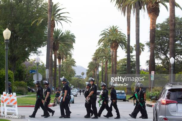 Los Angeles, CA JUNE 2, 2020: The LAPD walk away after peaceful protestors gather outside Los Angeles Mayor Eric Garcettis Hancock Park house as they...